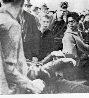 Maxine Walker Looks Askance as Paul Laprad is Pulled off his seat at lunch counter sit in 1960