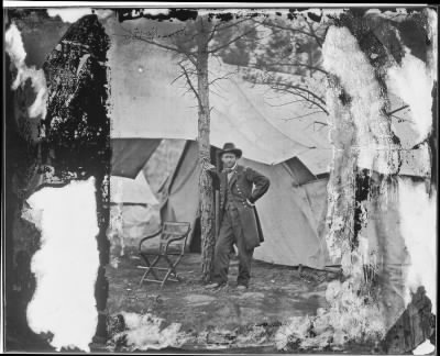 Mathew B Brady Collection of Civil War Photographs › B-36 Lieutenant General Ulysses S. Grant Standing by a Tree in Front of a Tent, Cold Harbor, Virginia. - Fold3.com