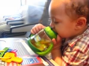 Junaid on the plane heading to Pakistan with his mommy