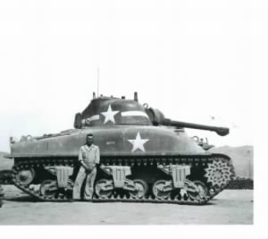 JOHN H. BOLLEN WITH HIS TANK.