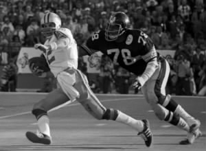 Dwight White pursues Roger Staubach in Super Bowl X