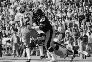 Ernie Holmes  taking down Roger Staubach in Super Bowl X