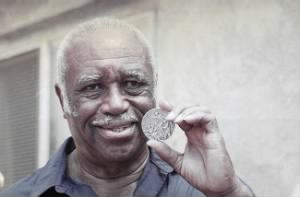 Mack-Robinson-with-Silver-Medal.jpg