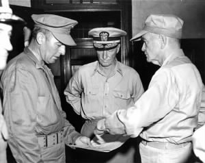 Brigadier General William T. Clement, USMC (left), Fleet Admiral Chester W. Nimitz, USN (center) and Admiral William F. Halsey, USN (right.jpg