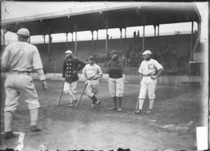 Frank Isbell of White Sox and Johnny Kling of Cubs, standing in the foul zone behind home plate. 1905.jpg