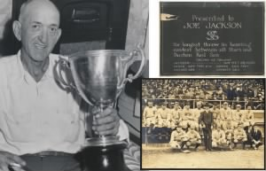 jackson-w-trophy-and-card-from-scrapbook.jpg